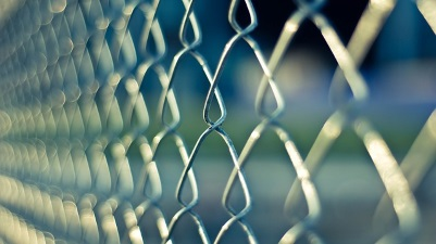 Waukesha County Jail Represented by Chain Link Fence