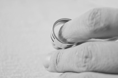 Divorce in Waukesha Represented by Hand Holding Wedding Ring